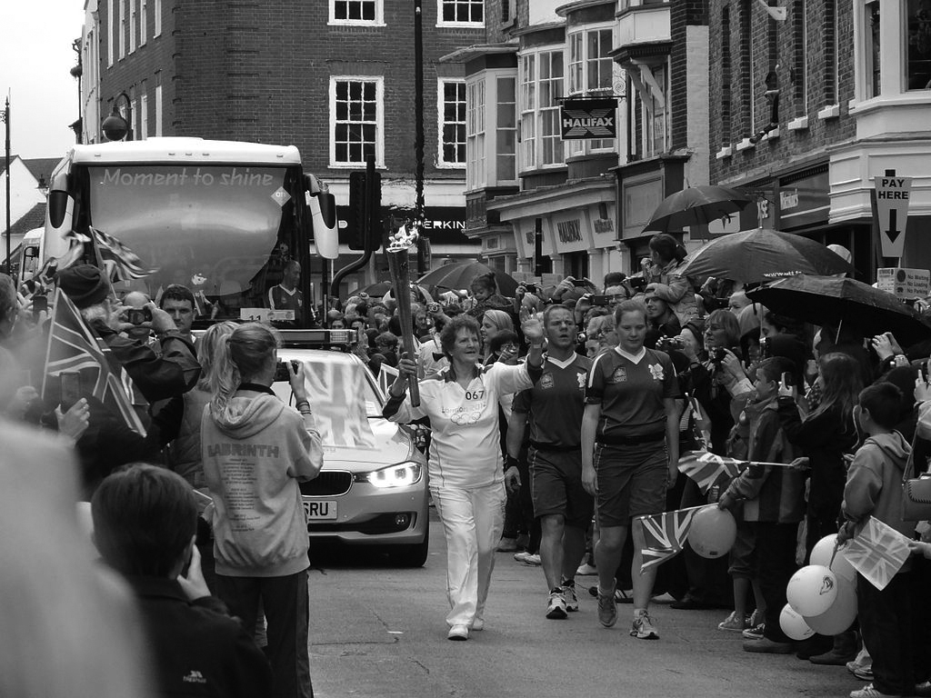 1024px-Olympic_torch_relay_through_Newport